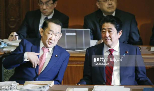 Japanese Prime Minister Shinzo Abe and Justice Minister Katsutoshi Kaneda attend a House of Councillors plenary session in Tokyo on May 29 2017...