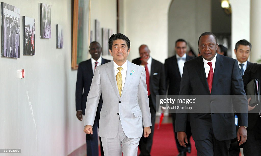 Japanese Prime Minister Shinzo Abe and Kenyan President Uhuru Kenyatta are seen prior to a meeting on the sidelines of the Tokyo International...