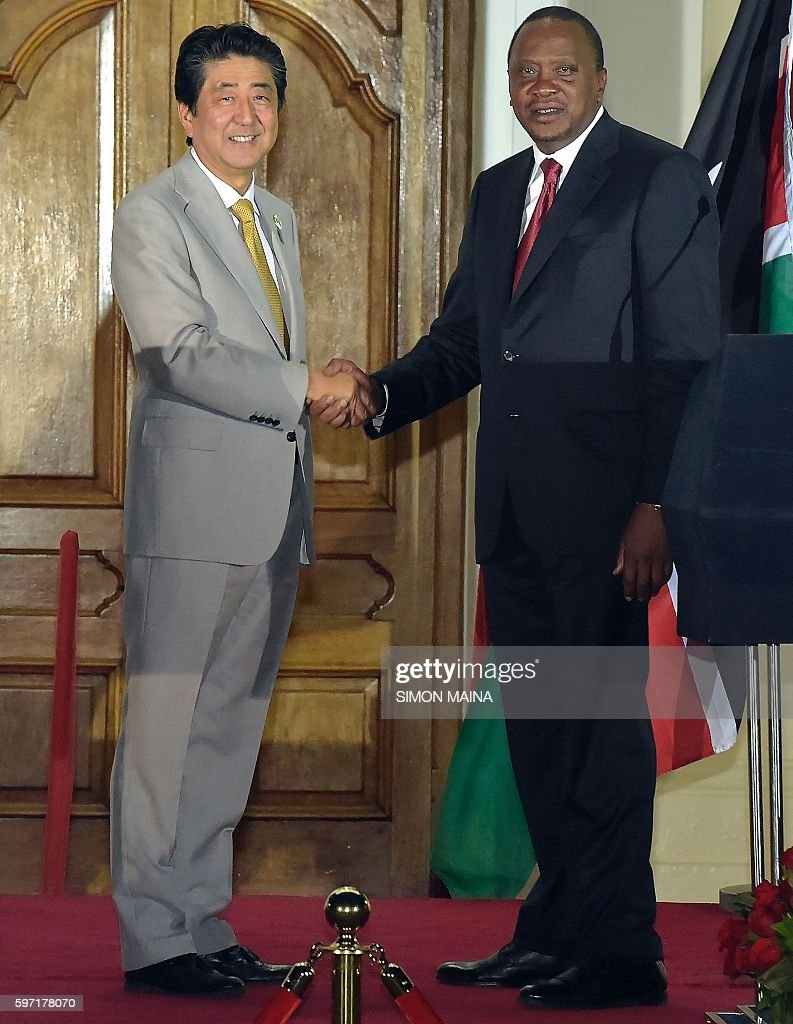 Japanese Prime Minister Shinzo Abe and Kenya's President Uhuru Kenyatta shakes hands after a joint press conference with Kenya's President at the...