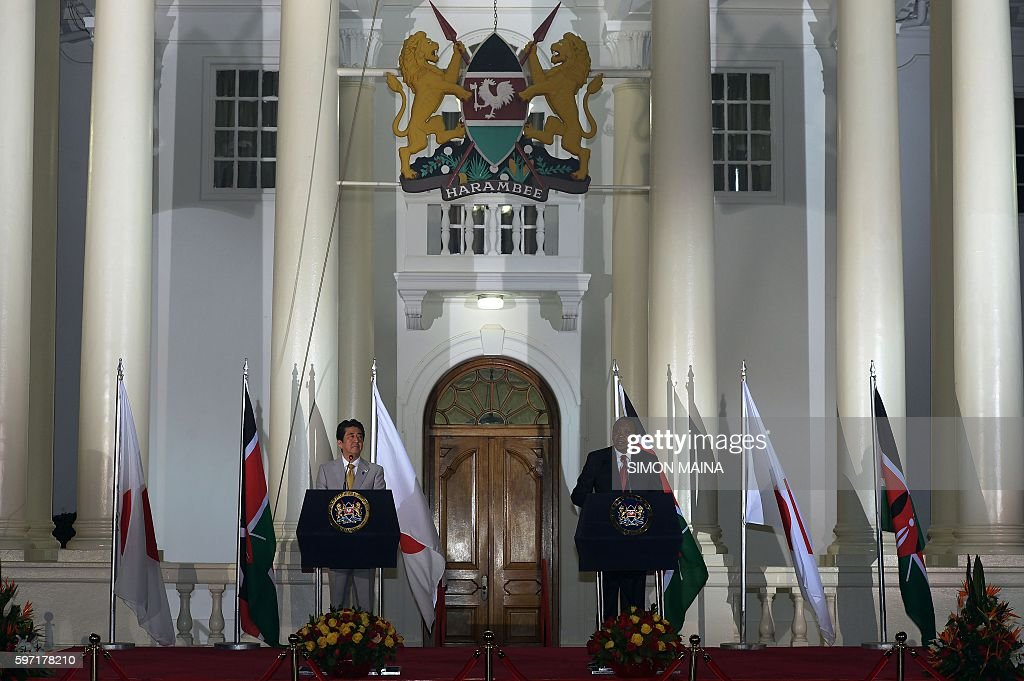 Japanese Prime Minister Shinzo Abe and Kenya's President Uhuru Kenyatta speak during a joint press conference with Kenya's President at the State...