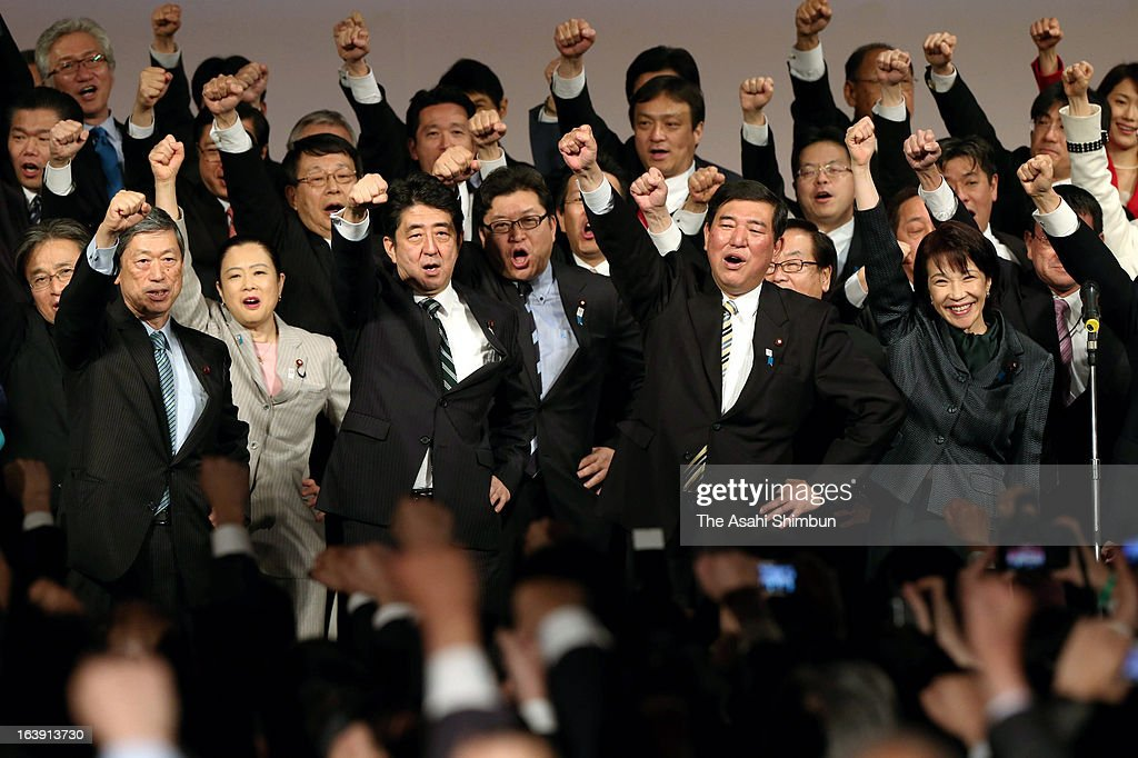 Japanese prime minister <a gi-track='captionPersonalityLinkClicked' href=/galleries/search?phrase=Shinzo+Abe&family=editorial&specificpeople=559017 ng-click='$event.stopPropagation()'>Shinzo Abe</a> (3rd L front row) and Liberal Democratic Party Secretary General <a gi-track='captionPersonalityLinkClicked' href=/galleries/search?phrase=Shigeru+Ishiba&family=editorial&specificpeople=2921096 ng-click='$event.stopPropagation()'>Shigeru Ishiba</a> (2nd R front row) react during LDP's annual convention on March 17, 2013 in Tokyo, Japan.