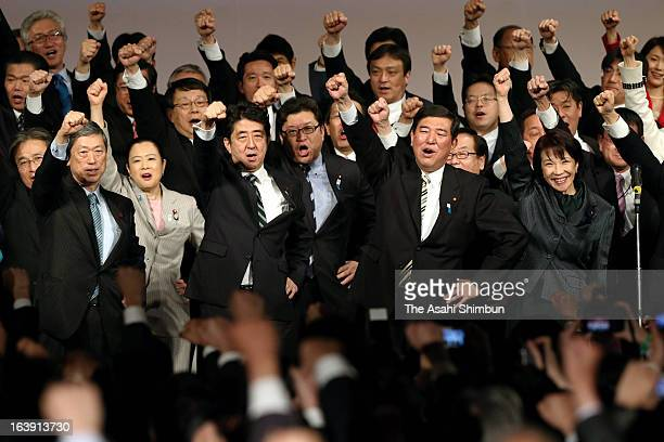 Japanese prime minister Shinzo Abe and Liberal Democratic Party Secretary General Shigeru Ishiba react during LDP's annual convention on March 17...
