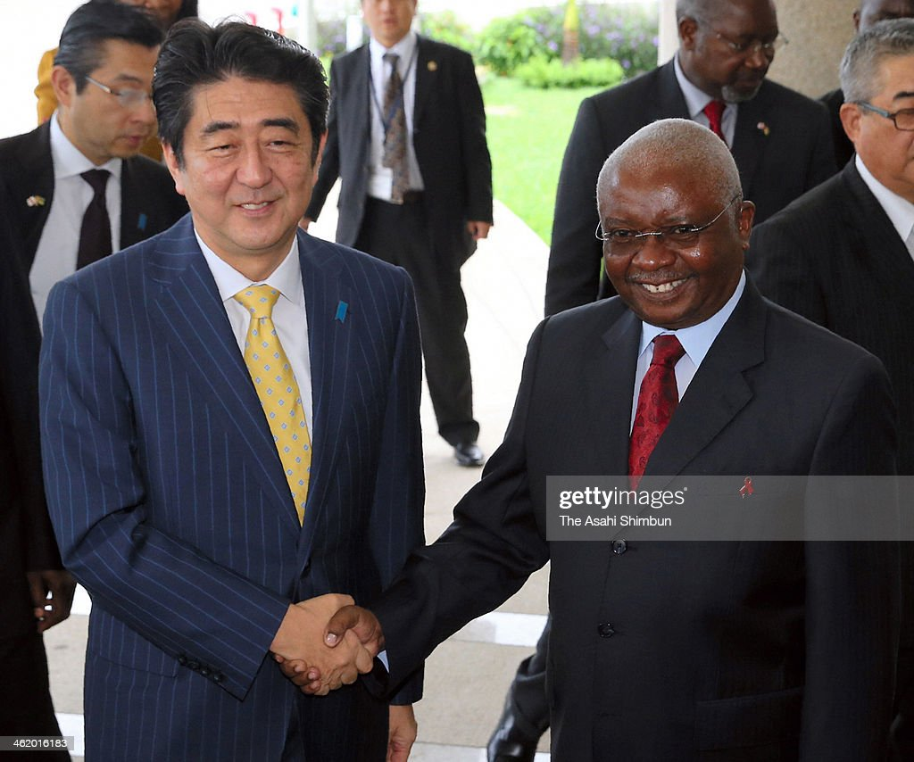 Japanese Prime Minister <a gi-track='captionPersonalityLinkClicked' href=/galleries/search?phrase=Shinzo+Abe&family=editorial&specificpeople=559017 ng-click='$event.stopPropagation()'>Shinzo Abe</a> (L) and Mozambique President <a gi-track='captionPersonalityLinkClicked' href=/galleries/search?phrase=Armando+Guebuza&family=editorial&specificpeople=569903 ng-click='$event.stopPropagation()'>Armando Guebuza</a> shake hands prior to their summit meeting on January 12, 2014 in Maputo, Mozambique. Abe is on tour to Oman, Ivory Coast, Mozambique and Ethiopia.