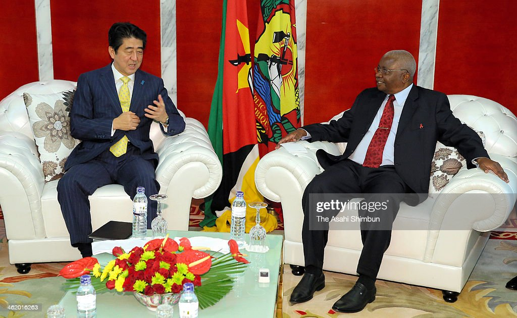 Japanese Prime Minister <a gi-track='captionPersonalityLinkClicked' href=/galleries/search?phrase=Shinzo+Abe&family=editorial&specificpeople=559017 ng-click='$event.stopPropagation()'>Shinzo Abe</a> (L) and Mozambique President <a gi-track='captionPersonalityLinkClicked' href=/galleries/search?phrase=Armando+Guebuza&family=editorial&specificpeople=569903 ng-click='$event.stopPropagation()'>Armando Guebuza</a> attend their summit meeting on January 12, 2014 in Maputo, Mozambique. Abe is on tour to Oman, Ivory Coast, Mozambique and Ethiopia.