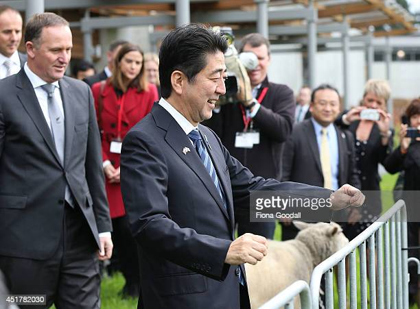 Japanese Prime Minister Shinzo Abe and New Zealand Prime Minister John Key arrive at Villa Maria Winery to meet with English students from a new...