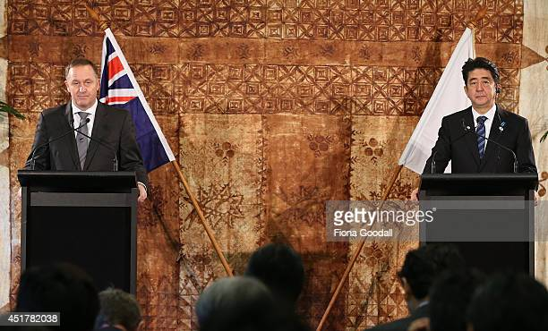 Japanese Prime Minister Shinzo Abe and New Zeland Prime Minister John Key speak to the media after a traditional Maori welcome at Government House on...