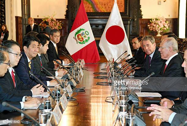 Japanese Prime Minister Shinzo Abe and Peruvian President Pedro Pablo Kuczynski talk during their meeting on November 18 2016 in Lima Peru Abe in...