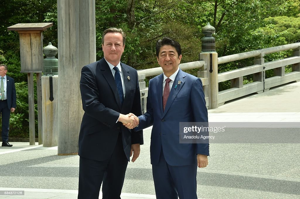 Japanese Prime Minister Shinzo Abe (R) and Prime Minister David Cameron (L) shake hands prior to G7 leaders summit at the Ise Jingu (Shrine) on May 26, 2016 in Ise, Mie Prefecture, Japan.