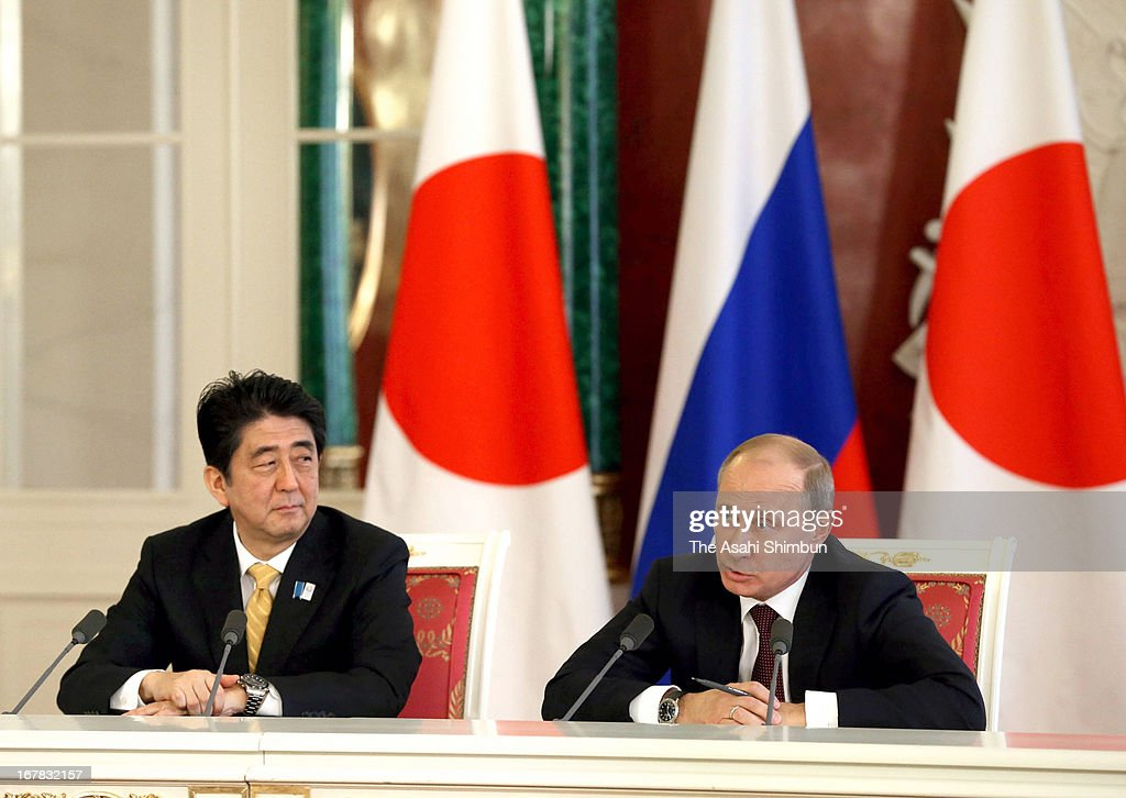 Japanese Prime Minister <a gi-track='captionPersonalityLinkClicked' href=/galleries/search?phrase=Shinzo+Abe&family=editorial&specificpeople=559017 ng-click='$event.stopPropagation()'>Shinzo Abe</a> and Russian President <a gi-track='captionPersonalityLinkClicked' href=/galleries/search?phrase=Vladimir+Putin&family=editorial&specificpeople=154896 ng-click='$event.stopPropagation()'>Vladimir Putin</a> attend a joint press conference at Klemrin on April 29, 2013 in Moscow, Russia. Two countries agreed to restart talks to resolve the territorial dispute of so-called the Northern Territory.