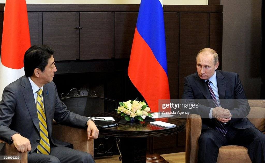 Japanese Prime Minister Shinzo Abe (L) and Russian President Vladimir Putin (R) are seen during their meeting in Sochi, Russia on May 6, 2016.