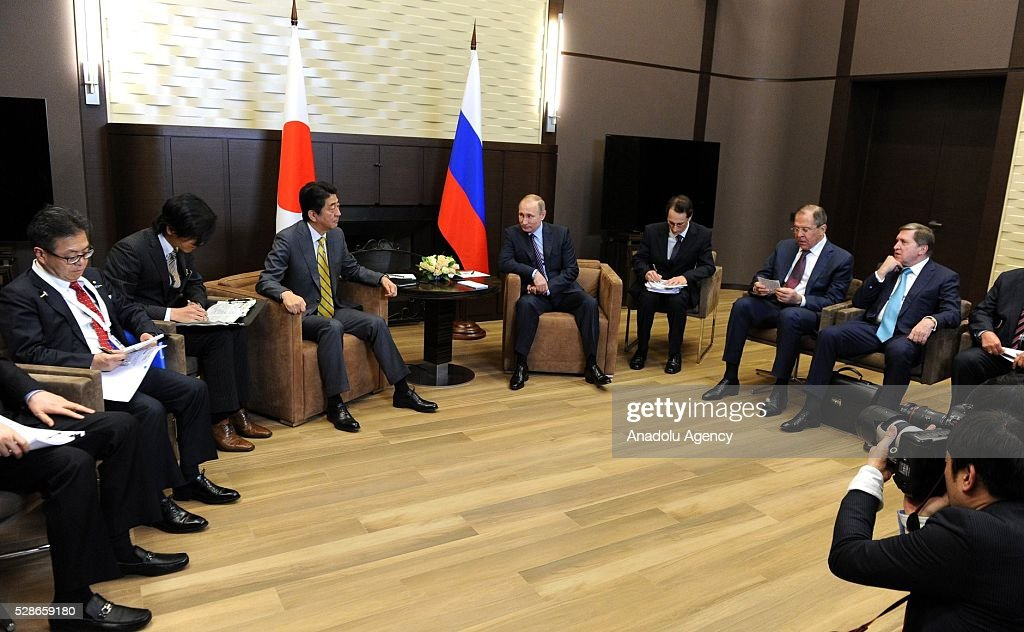 Japanese Prime Minister Shinzo Abe (3rd L) and Russia's President Vladimir Putin (4th L) attend a meeting in Sochi, Russia on May 6, 2016.
