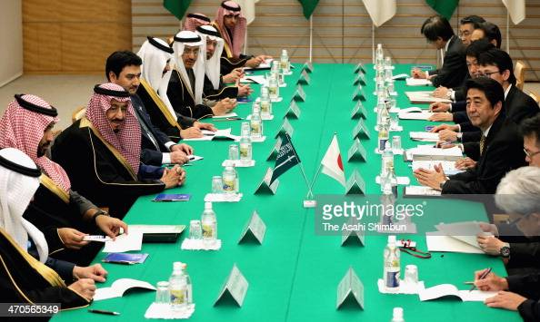 Japanese Prime Minister Shinzo Abe and Saudi Arabian Crown Prince Salman bin Abdulaziz Al Saudon left center attend a meeting at Abe's official...