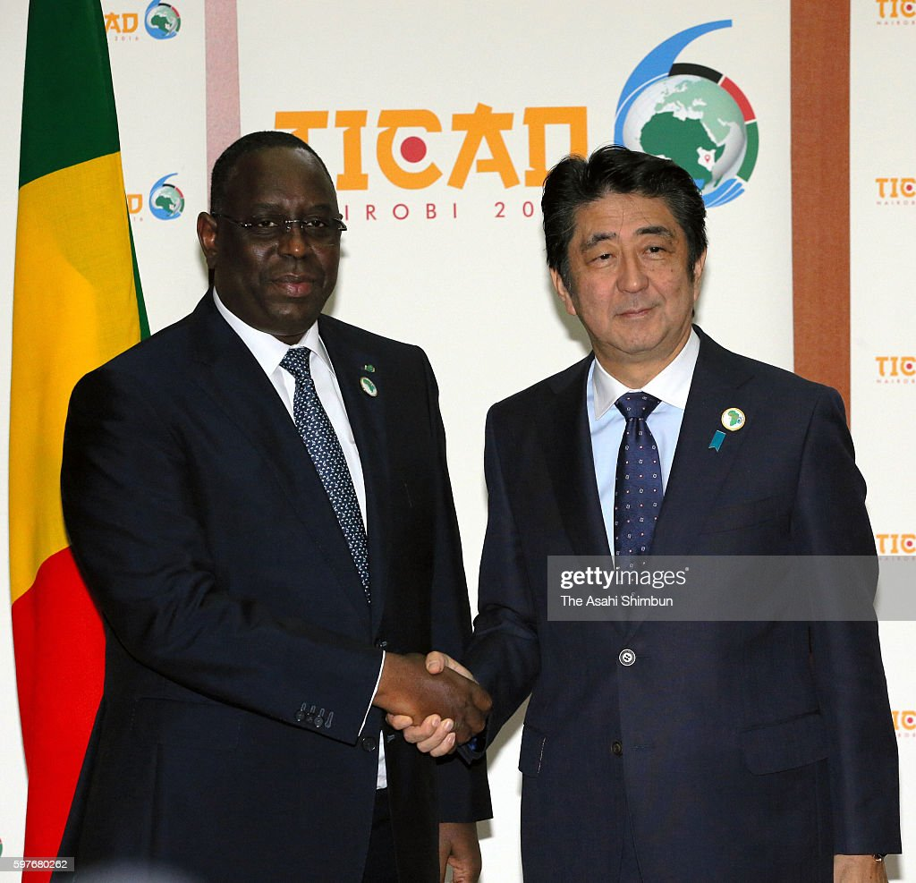 Japanese Prime Minister Shinzo Abe and Senegalese President Macky Sall shake hands on the sidelines of the Tokyo International Conference on African...