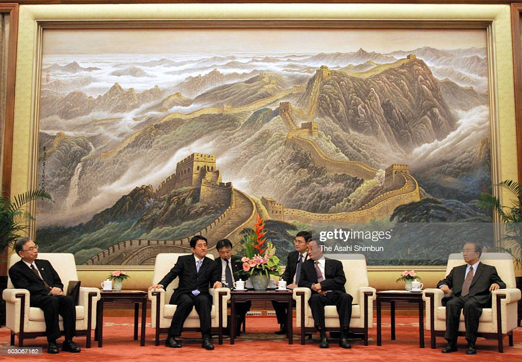 Japanese Prime Minister Shinzo Abe and Standing Committee of the National People's Congress Chairman Wu Bangguo talk during their meeting at the...