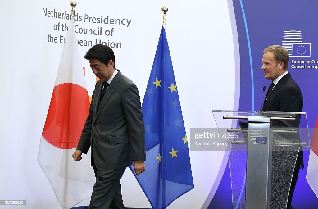 Japanese Prime Minister Shinzo Abe (L) and the President of the European Council Donald Tusk (R) leave following a joint press conference after the EU - Japan leaders' meeting at the EU headquarters in Brussels on May 3, 2016.