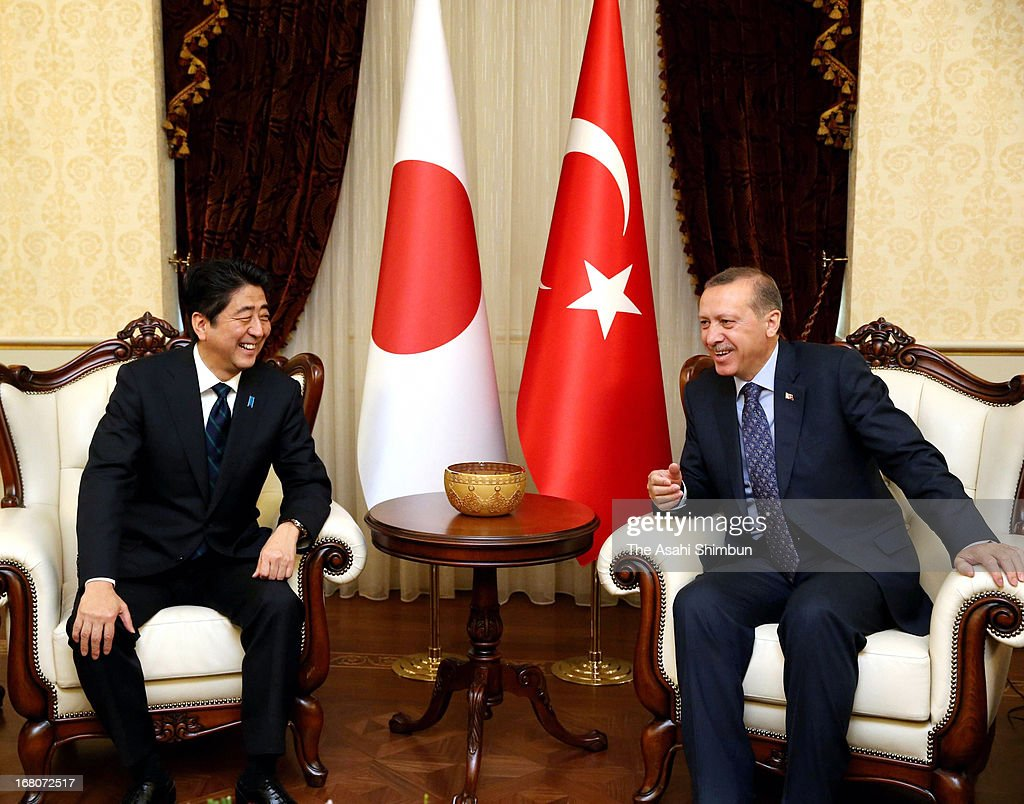 Japanese Prime Minister <a gi-track='captionPersonalityLinkClicked' href=/galleries/search?phrase=Shinzo+Abe&family=editorial&specificpeople=559017 ng-click='$event.stopPropagation()'>Shinzo Abe</a> (L) and Turkish Prime Minister <a gi-track='captionPersonalityLinkClicked' href=/galleries/search?phrase=Recep+Tayyip+Erdogan&family=editorial&specificpeople=213890 ng-click='$event.stopPropagation()'>Recep Tayyip Erdogan</a> pose for photographs during their summit meeting on May 3, 2013 in Ankara, Turkey. Abe is on the tour to Russia and Middle East.