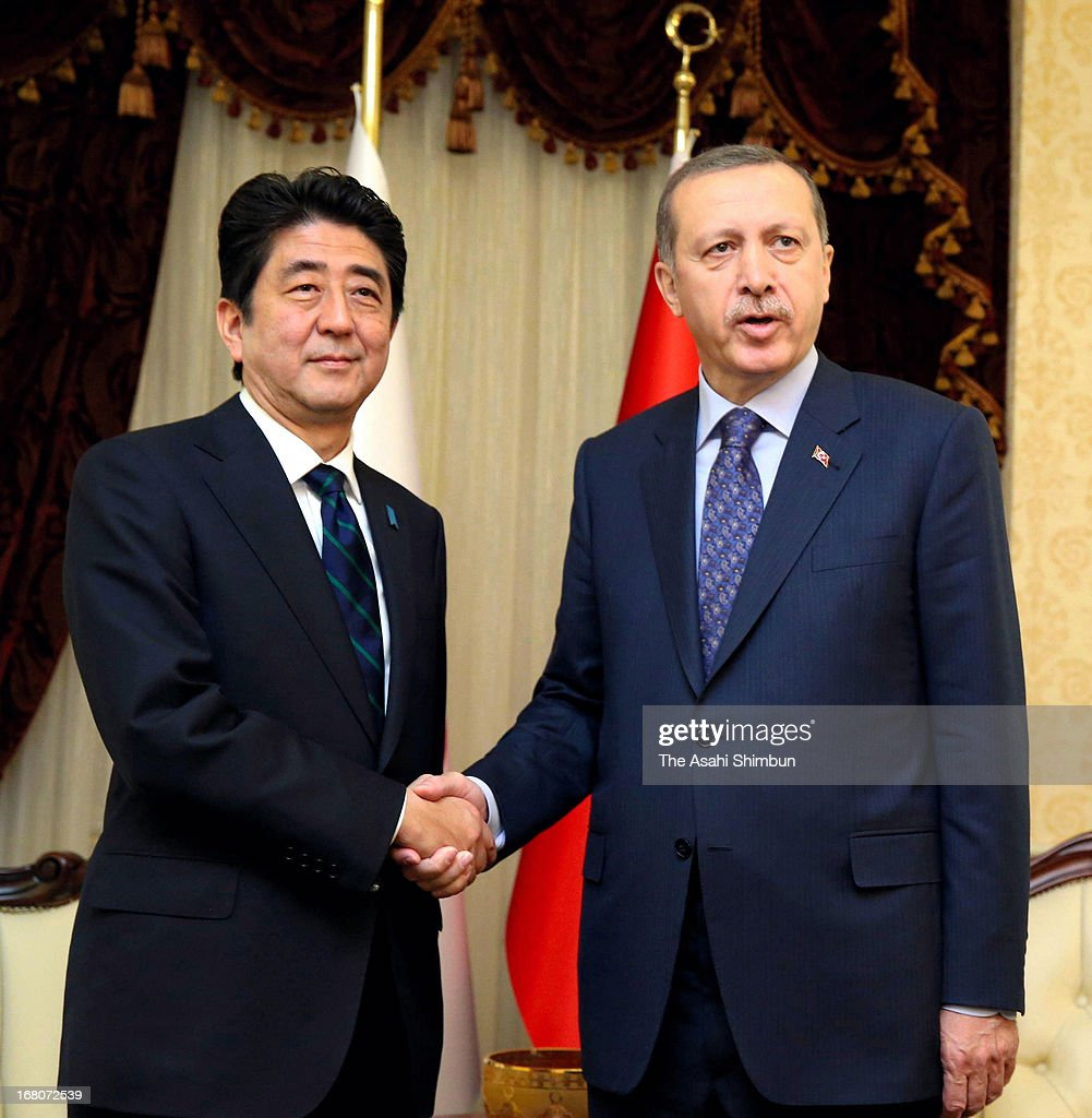 Japanese Prime Minister <a gi-track='captionPersonalityLinkClicked' href=/galleries/search?phrase=Shinzo+Abe&family=editorial&specificpeople=559017 ng-click='$event.stopPropagation()'>Shinzo Abe</a> (L) and Turkish Prime Minister <a gi-track='captionPersonalityLinkClicked' href=/galleries/search?phrase=Recep+Tayyip+Erdogan&family=editorial&specificpeople=213890 ng-click='$event.stopPropagation()'>Recep Tayyip Erdogan</a> shake hands during their summit meeting on May 3, 2013 in Ankara, Turkey. Abe is on the tour to Russia and Middle East.