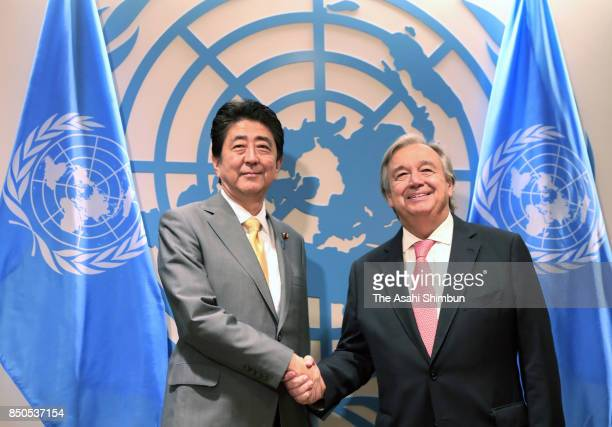Japanese Prime Minister Shinzo Abe and United Nations SecretaryGeneral Antonio Guterres shake hands prior to their meeting at the UN headquarters on...