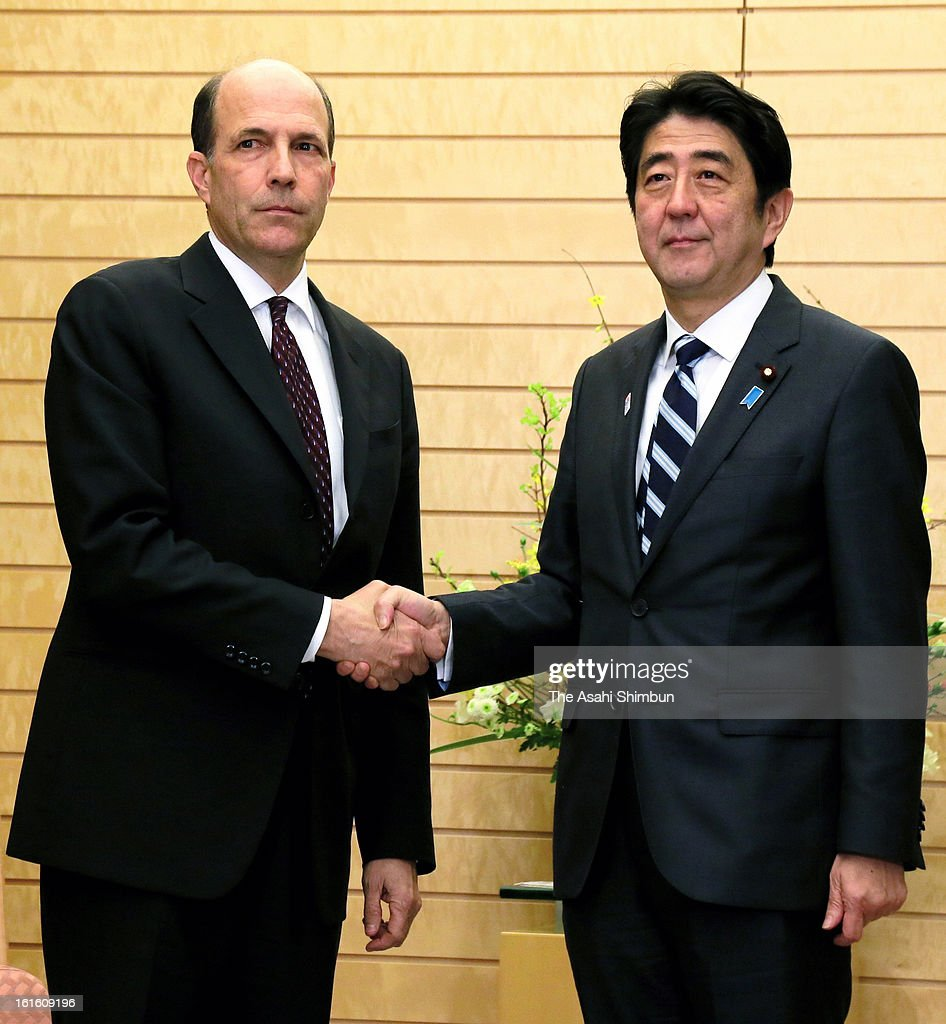Japanese Prime Minister <a gi-track='captionPersonalityLinkClicked' href=/galleries/search?phrase=Shinzo+Abe&family=editorial&specificpeople=559017 ng-click='$event.stopPropagation()'>Shinzo Abe</a> and U.S. Ambassador to Japan John Roos shake hands during an emergency meeting after North Korea's third nuclear test at Abe's official residence on February 12, 2013 in Tokyo, Japan. North Korea confirmed it had successfully carried out an underground nuclear test as a shallow earthquake with a magnitude of 4.9 was detected by several international monitoring agencies. South Korea and Japan both assembled an emergency meeting of their respective national security teams after the incident.