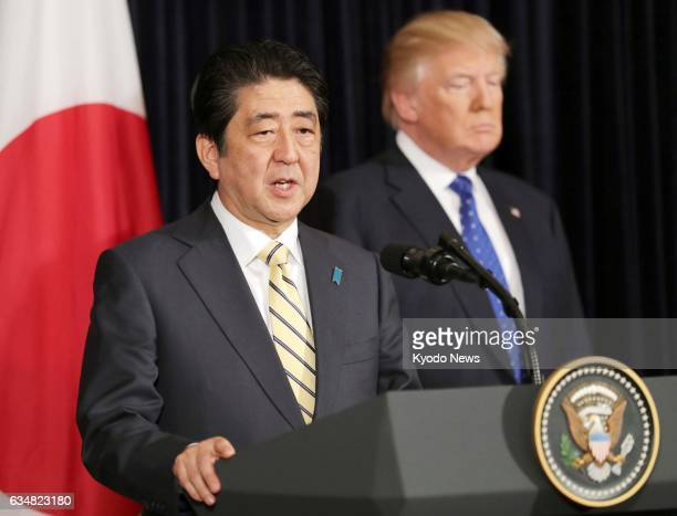 Japanese Prime Minister Shinzo Abe and US President Donald Trump attend a joint press conference in Palm Beach Florida on Feb 11 responding to the...