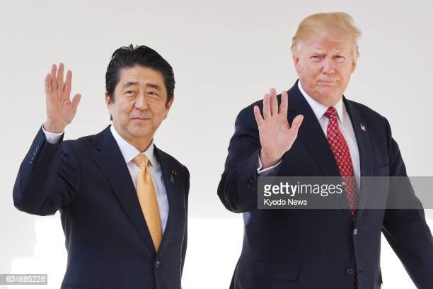 Japanese Prime Minister Shinzo Abe and US President Donald Trump are seen at the White House in Washington on Feb 10 2017