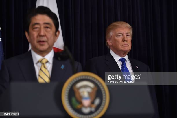 Japanese Prime Minister Shinzo Abe and US President Donald Trump speak at Trump's MaraLago resort in Palm Beach Florida on February 11 after North...
