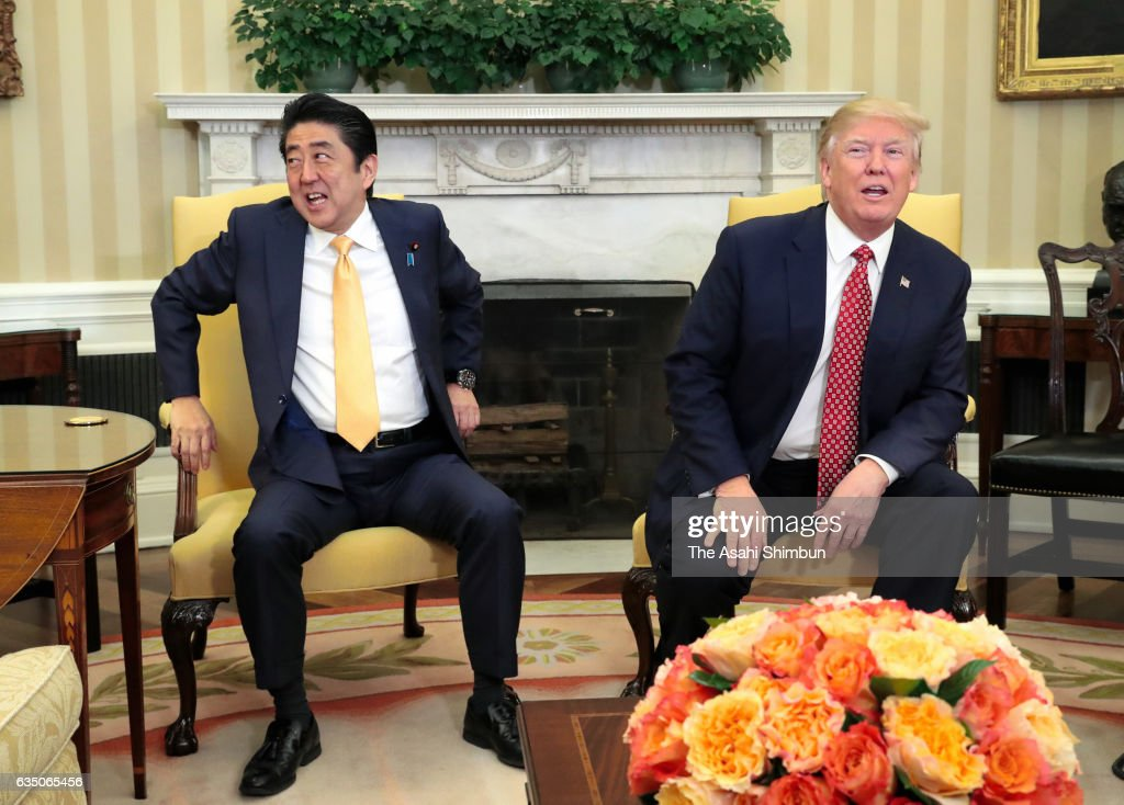 Japanese Prime Minister Shinzo Abe and U.S. President Donald Trump talk during their bilateral meeting in the Oval Office at the White House on February 10, 2017 in Washington, DC. Trump and Abe are expected to discuss many issues, including trade and security ties.