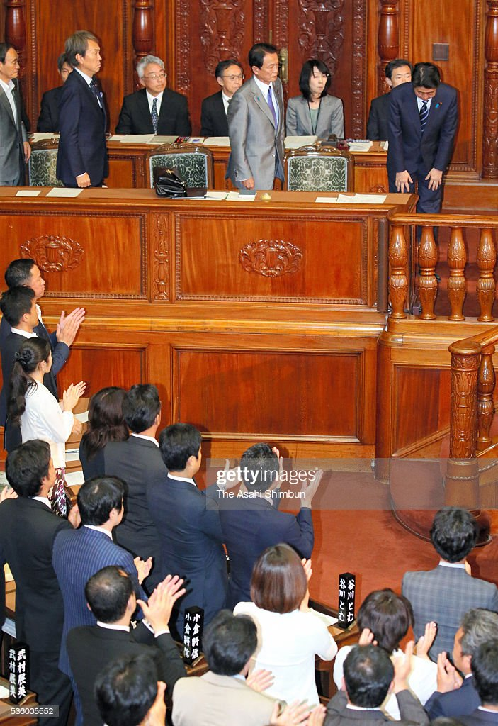 Japanese Prime Minister <a gi-track='captionPersonalityLinkClicked' href=/galleries/search?phrase=Shinzo+Abe&family=editorial&specificpeople=559017 ng-click='$event.stopPropagation()'>Shinzo Abe</a> (R) and Vice Prime Minister and Finance Minister <a gi-track='captionPersonalityLinkClicked' href=/galleries/search?phrase=Taro+Aso&family=editorial&specificpeople=559212 ng-click='$event.stopPropagation()'>Taro Aso</a> (L) bow after the no-confidence motion against his cabinet is voted down while ruling party lawmakers applaud at the lower house plenary session of the diet on May 31, 2016 in Tokyo, Japan. A decision to delay raising the consumption tax rate was first mooted in 2014. It was to have been implemented in October the following year. It was put off until April 2017. The increase is now slated to take effect in October 2019.