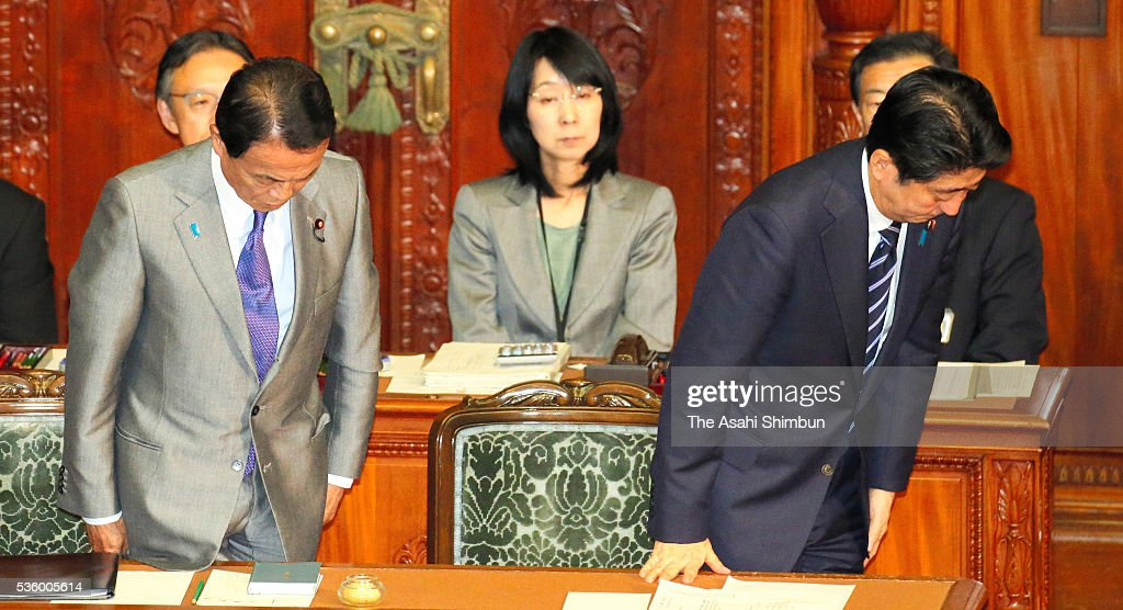 Japanese Prime Minister <a gi-track='captionPersonalityLinkClicked' href=/galleries/search?phrase=Shinzo+Abe&family=editorial&specificpeople=559017 ng-click='$event.stopPropagation()'>Shinzo Abe</a> (R) and Vice Prime Minister and Finance Minister <a gi-track='captionPersonalityLinkClicked' href=/galleries/search?phrase=Taro+Aso&family=editorial&specificpeople=559212 ng-click='$event.stopPropagation()'>Taro Aso</a> (L) bow after the no-confidence motion against his cabinet is voted down at the lower house plenary session of the diet on May 31, 2016 in Tokyo, Japan. A decision to delay raising the consumption tax rate was first mooted in 2014. It was to have been implemented in October the following year. It was put off until April 2017. The increase is now slated to take effect in October 2019.