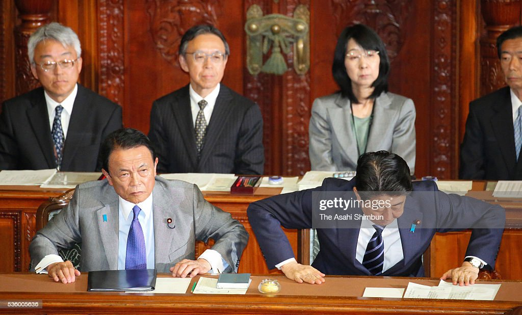 Japanese Prime Minister <a gi-track='captionPersonalityLinkClicked' href=/galleries/search?phrase=Shinzo+Abe&family=editorial&specificpeople=559017 ng-click='$event.stopPropagation()'>Shinzo Abe</a> (R) and Vice Prime Minister and Finance Minister <a gi-track='captionPersonalityLinkClicked' href=/galleries/search?phrase=Taro+Aso&family=editorial&specificpeople=559212 ng-click='$event.stopPropagation()'>Taro Aso</a> (L) stand to bow after the no-confidence motion against his cabinet is voted down at the lower house plenary session of the diet on May 31, 2016 in Tokyo, Japan. A decision to delay raising the consumption tax rate was first mooted in 2014. It was to have been implemented in October the following year. It was put off until April 2017. The increase is now slated to take effect in October 2019.
