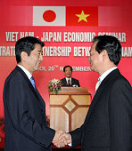 Japanese Prime Minister Shinzo Abe and Vietnamese Prime Minister Nguyen Tan Dung shake hands during a VietnamJapan Economic Seminar after the APEC...