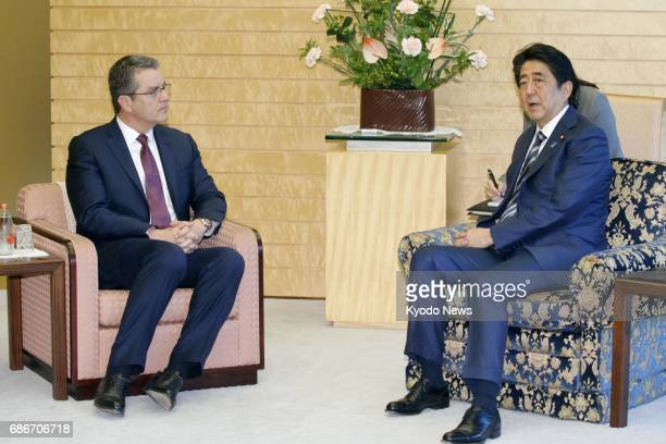 Japanese Prime Minister Shinzo Abe and World Trade Organization Director General Roberto Azevedo hold talks in Tokyo on May 22 2017 Japan and the WTO...