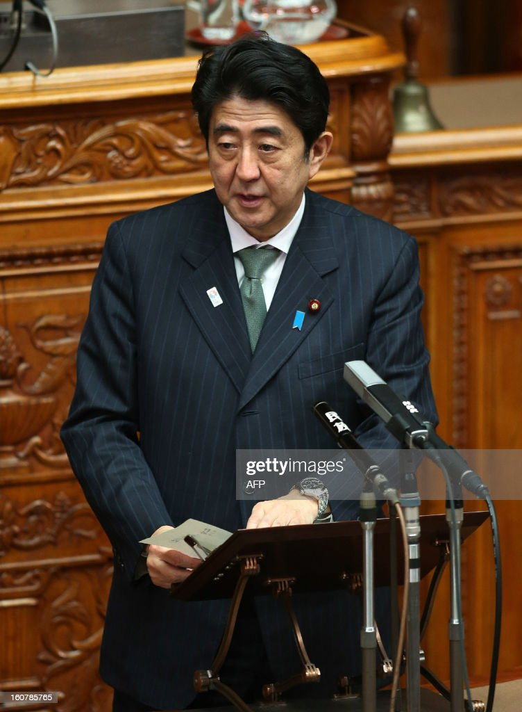 Japanese Prime Minister Shinzo Abe answers questions at the Upper House's plenary session at the National Diet in Tokyo on February 6, 2013. The radar-lock that a Chinese frigate put on a Japanese warship was 'dangerous' and 'provocative', Abe said, as tensions in a territorial row ratcheted up.