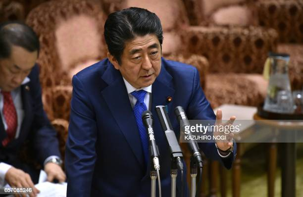 Japanese Prime Minister Shinzo Abe answers questions during a budget committee session of the House of Councilors at the Parliament in Tokyo on March...