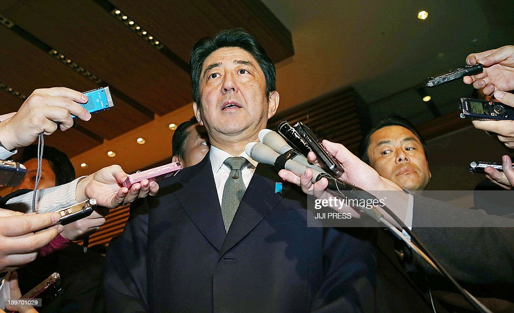 Japanese Prime Minister Shinzo Abe (2nd R) answers questions from reporters after a cabinet-level meeting to co-ordinate its response to hostage issues in Algeria at the prime minister's official residence in Tokyo on January 19, 2013. Abe came back home on January 19 from his tour to Southeast Asian countries earlier than his original schedule to take charge of Japan's response to the desert hostage crisis in which at least 10 of its nationals are still missing. AFP PHOTO/Jiji Press JAPAN OUT