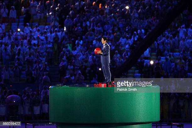 Japanese Prime Minister Shinzo Abe appears from the pipe duirng the flag handover segment during the Closing Ceremony on Day 16 of the Rio 2016...