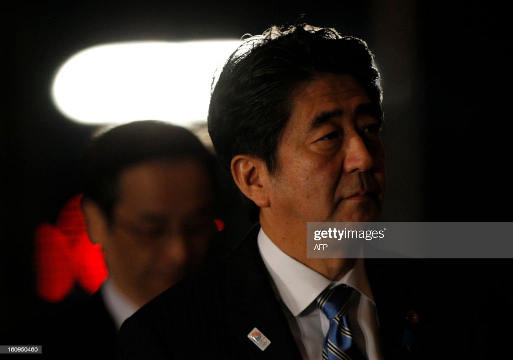Japanese Prime Minister Shinzo Abe arreives to attend an advisory panel on restructuring legal infrastructure of security guarantees at Abe's official residence in Tokyo on February 8, 2013. AFP PHOTO / Issei Kato / POOL