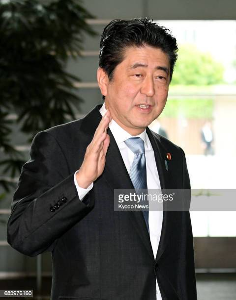 Japanese Prime Minister Shinzo Abe arrives at his office in Tokyo on May 17 2017 A document has been uncovered suggesting Abe was involved in the...