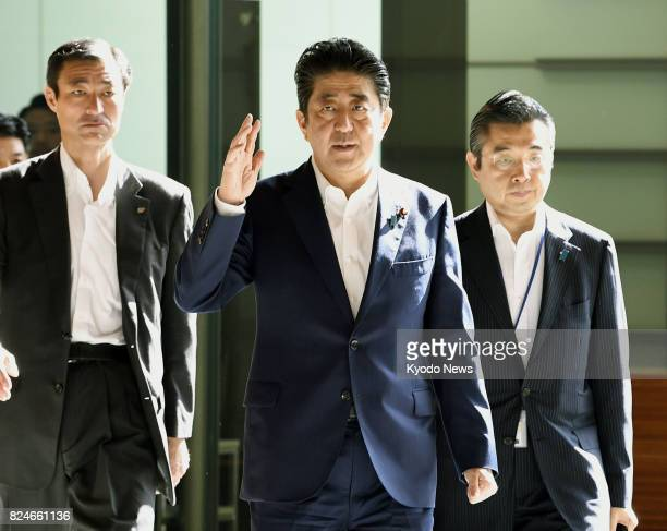 Japanese Prime Minister Shinzo Abe arrives at his office in Tokyo on July 31 to hold telephone talks with US President Donald Trump following North...
