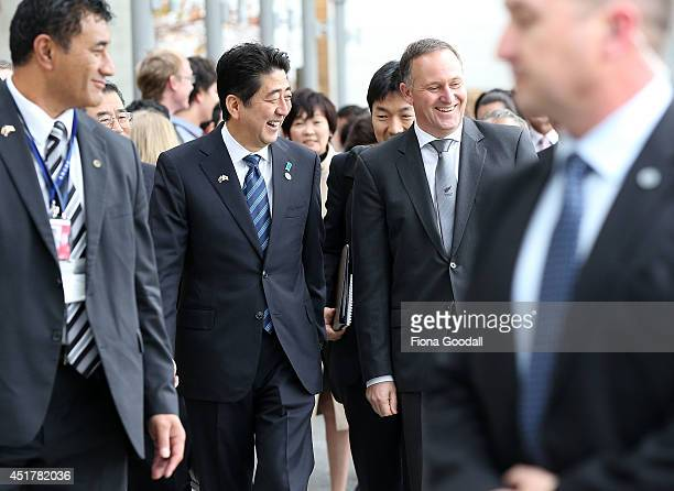 Japanese Prime Minister Shinzo Abe arrives at Villa Maria Winery with New Zealand Prime Minister John Key on July 7 2014 in Auckland New Zealand...