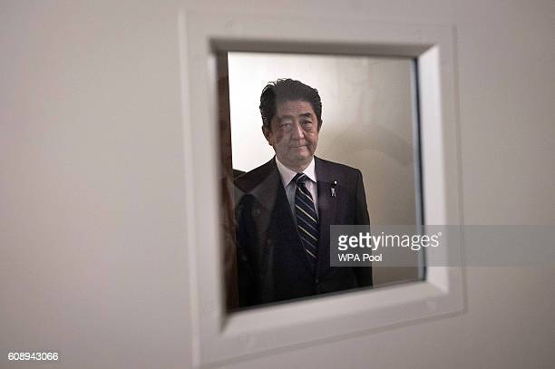 Japanese Prime Minister Shinzo Abe arrives for a bilateral meeting with British Prime Minister Theresa May at the United Nations Headquarters on...