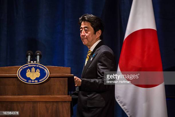 Japanese Prime Minister Shinzo Abe arrives for a news conference on February 22 2013 in Washington DC Abe is in Washington to meet with President...