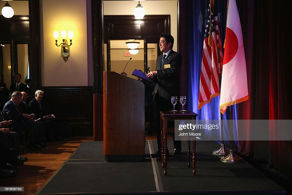 Japanese Prime Minister <a gi-track='captionPersonalityLinkClicked' href=/galleries/search?phrase=Shinzo+Abe&family=editorial&specificpeople=559017 ng-click='$event.stopPropagation()'>Shinzo Abe</a> arrives to give a speech to guests at the New York Stock Exchange before ringing the closing bell on September 25, 2013 in New York City. Abe spoke on 'Abenomics' and Japan's economic recovery.