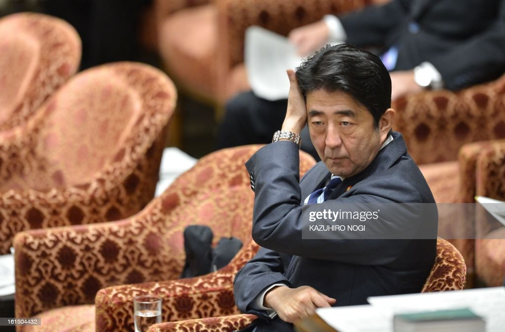 Japanese Prime Minister Shinzo Abe attends a budget committee session of the lower house at parliament in Tokyo on February 12, 2013