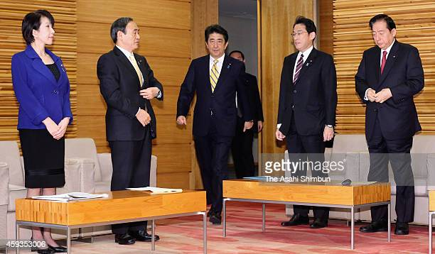 Japanese Prime Minister Shinzo Abe attends a cabinet members meeting at his official residence on November 21 2014 in Tokyo Japan The Lower House was...