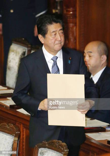 Japanese Prime Minister Shinzo Abe attends a House of Representatives plenary session in Tokyo on Dec 5 2017 The lower house adopted a resolution...