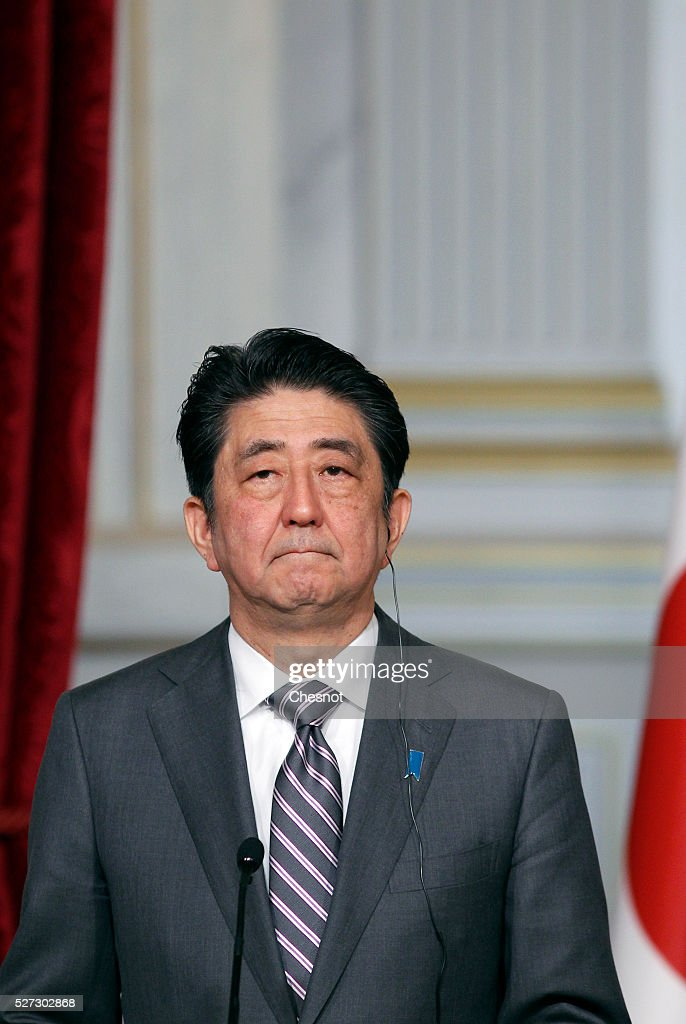 Japanese Prime Minister Shinzo Abe attends a joint press conference with French President Francois Hollande at the Elysee Presidential Palace on May 2, 2016 in Paris, France. Shinzo Abe began a week-long trip to several European countries and Russia prior to the G7 Summit to be held on May 26 and 27, 2016 in Japan.