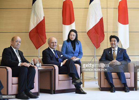 Japanese Prime Minister Shinzo Abe attends a meeting with French Defense Minister JeanYves Le Drian and Foreign Minister Laurent Fabius at Abe's...