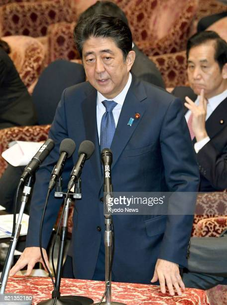 Japanese Prime Minister Shinzo Abe attends an ad hoc parliamentary committee session in Tokyo on July 24 over favoritism allegations against him...