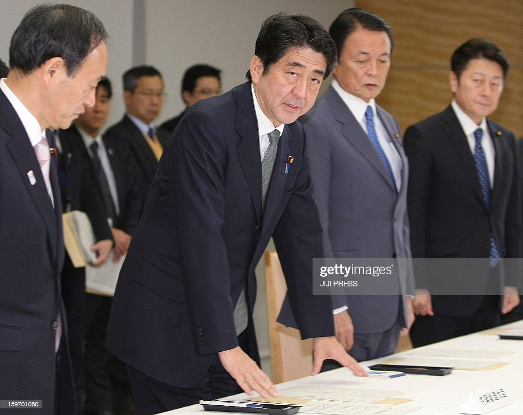 Japanese Prime Minister Shinzo Abe (2nd L) attends at a cabinet-level meeting to co-ordinate its response to hostage issues in Algeria, at the prime minister's official residence in Tokyo on January 19, 2013. Abe came back home on January 19 from his tour to Southeast Asian countries earlier than his original schedule to take charge of Japan's response to the desert hostage crisis in which at least 10 of its nationals are still missing. AFP PHOTO/Jiji Press JAPAN OUT